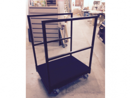 finished custom move cart with rails on the sidesto hold screens, panels, white boards, etc