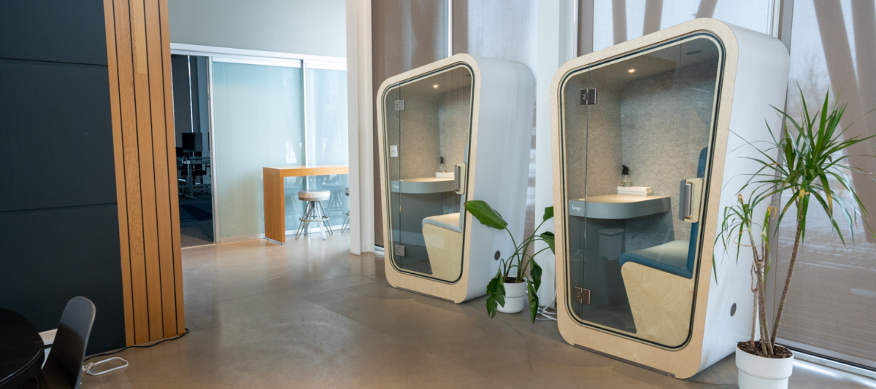 two loop phone booths in an open hybrid office environment