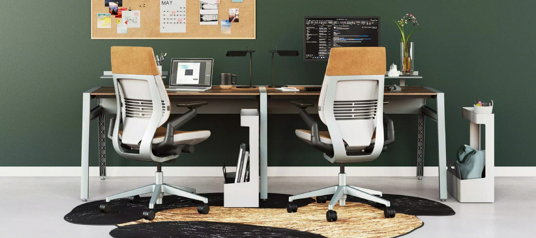 Two gesture task chairs at a benching workstation